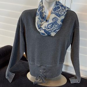 American Eagle distressed pull over lace up detail